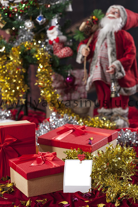 christmas gift boxes and santa claus